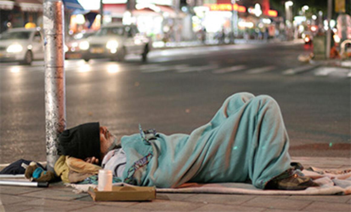 man sleeping in the street. © Istock