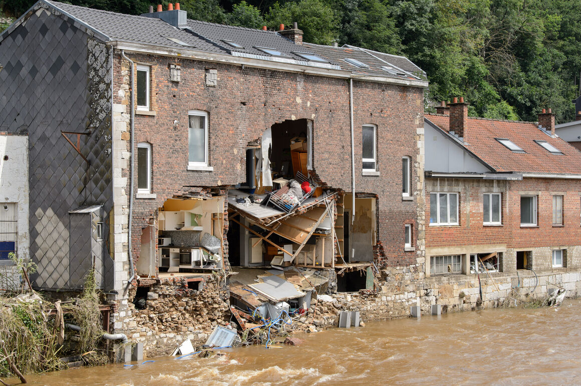 House with collapsed wall after flood in Belgium.
