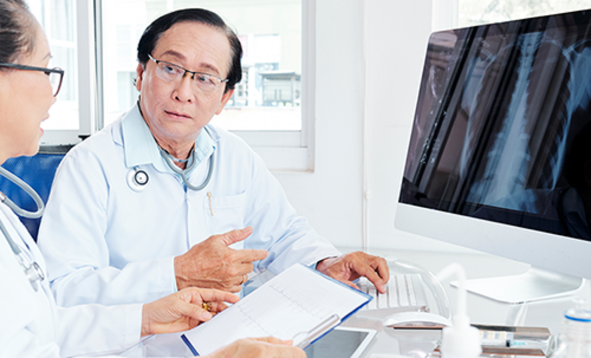 Asian doctors looking at x-ray