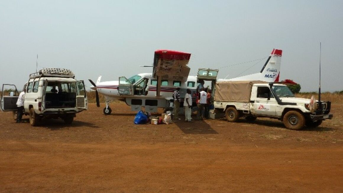 EPIET Postcard from the field - Plane and aid workers during measles outbreak, DRC